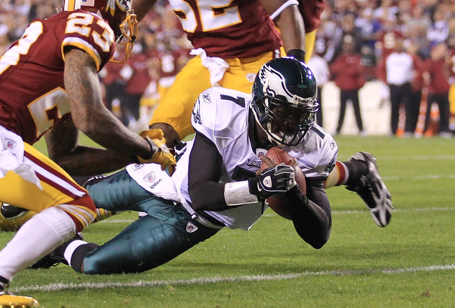 LANDOVER, MD - NOVEMBER 15:  Michael Vick #7 of the Philadelphia Eagles dives over to score a touchdown against the Washington Redskins on November 15, 2010 at FedExField in Landover, Maryland.  (Photo by Chris McGrath/Getty Images)