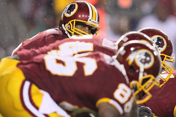 LANDOVER, MD - NOVEMBER 15:  Donovan McNabb #5 of the Washington Redskins looks down the line  against the Philadelphia Eagles on November 15, 2010 at FedExField in Landover, Maryland.  (Photo by Chris McGrath/Getty Images)