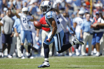 NASHVILLE - SEPTEMBER 12: Michael Griffin #33 of the Tennessee Titans runs with a fumble against the Oakland Raiders during the NFL season opener at LP Field on September 12, 2010 in Nashville, Tennessee. The Titans defeated the Raiders 38-13. (Photo by J