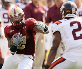 CHESTNUT HILL, MA - SEPTEMBER 25:  Montel Harris #2 of the Boston College Eagles carries the ball and tries to manuever around Davon Morgan #2 of the Virginia Tech Hokies on September 25, 2010 at Alumni Stadium in Chestnut Hill, Massachusetts.  (Photo by