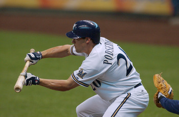 MILWAUKEE - JUNE 17:  Scott Podsednik #20 of the Milwaukee Brewers bunts during the game against the Seattle Mariners on June 17, 2004 at Miller Park in Milwaukee, Wisconsin. The Mariners won 6-3.  (Photo by Jonathan Daniel/Getty Images)