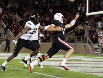 PALO ALTO, CA - SEPTEMBER 18:  Andrew Luck #12 of the Stanford Cardinal gets past Alex Frye #21 of the Wake Forest Demon Deacons to score a touchdown at Stanford Stadium on September 18, 2010 in Palo Alto, California.  (Photo by Ezra Shaw/Getty Images)
