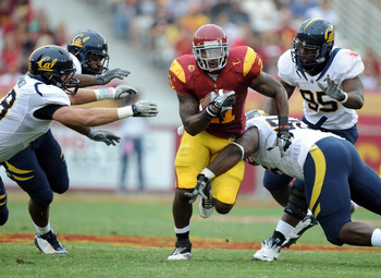 LOS ANGELES, CA - OCTOBER 16:  Allen Bradford #21 of the USC Trojans breaks through a hole in the California Golden Bears defence during the first quarter at Los Angeles Memorial Coliseum on October 16, 2010 in Los Angeles, California.  (Photo by Harry Ho