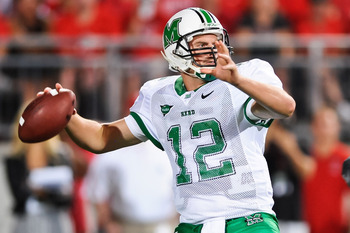 COLUMBUS, OH - SEPTEMBER 2: Quarterback Brian Anderson #12 of the Marshall Thundering Herd passes against the Ohio State Buckeyes at Ohio Stadium on September 2, 2010 in Columbus, Ohio. (Photo by Jamie Sabau/Getty Images)
