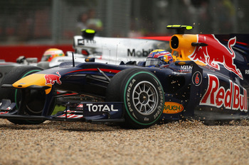Webber in the gravel after clipping Hamilton
