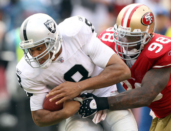 SAN FRANCISCO - OCTOBER 17:  Jason Campbell #8 of the Oakland Raiders is sacked by Parys Haralson #98 of the San Francisco 49ers at Candlestick Park on October 17, 2010 in San Francisco, California.  (Photo by Ezra Shaw/Getty Images)