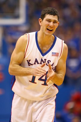 LAWRENCE, KS - NOVEMBER 25:  Tyrel Reed #14 of the Kansas Jayhawks celebrates during the game against the Oakland Golden Grizzlies on November 25, 2009 at Allen Fieldhouse in Lawrence, Kansas. (Photo by Jamie Squire/Getty Images)