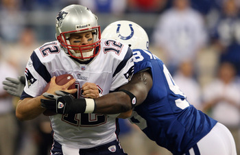 INDIANAPOLIS - NOVEMBER 04:  Tom Brady #12 of the New England Patriots is sacked by Robert Mathis #98 of the Indianapolis Colts on November 4, 2007 at the RCA Dome in Indianapolis, Indiana.  (Photo by Andy Lyons/Getty Images)