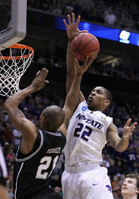 SALT LAKE CITY - MARCH 27:  Willie Veasley #21 of the Butler Bulldogs puts up a shot under pressure from Rodney McGruder #22 of the Kansas State Wildcats during the west regional final of the 2010 NCAA men's basketball tournament at the Energy Solutions A