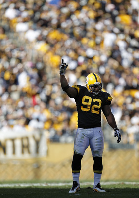 PITTSBURGH - OCTOBER 17:  James Harrison #92 of the Pittsburgh Steelers encourages the fans to make noise while playing the Cleveland Browns on October 17, 2010 at Heinz Field in Pittsburgh, Pennsylvania. Pittsburgh won the game 28-10.  (Photo by Gregory