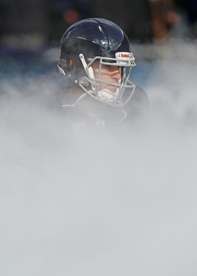 CHICAGO - NOVEMBER 14: Jay Cutler #6 of the Chicago Bears runs through smoke during player introductions before a game against the Minnesota Vikings at Soldier Field on November 14, 2010 in Chicago, Illinois. The Bears defeated the Vikings 27-13. (Photo b