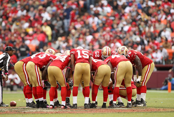 SAN FRANCISCO - OCTOBER 17: The San Francisco 49ers huddle together during their game against the Oakland Raiders at Candlestick Park on October 17, 2010 in San Francisco, California.  (Photo by Ezra Shaw/Getty Images)