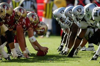 SAN FRANCISCO - OCTOBER 8:  The San Francisco 49ers offensive line lines up against the Oakland Raiders defensive line at Monster Park on October 8, 2006 in San Francisco, California. The Niners defeated the Raiders 34-20.  (Photo by Jed Jacobsohn/Getty I