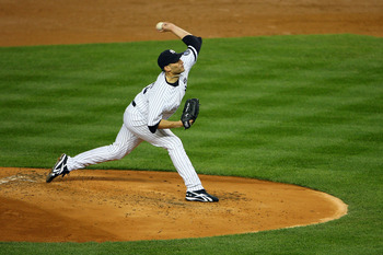 NEW YORK - OCTOBER 18:  Andy Pettitte #46 of the New York Yankees pitches against the Texas Rangers in Game Three of the ALCS during the 2010 MLB Playoffs at Yankee Stadium on October 18, 2010 in New York, New York.  (Photo by Andrew Burton/Getty Images)