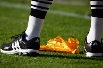 TUSCALOOSA, AL - NOVEMBER 07:  An official stands over a penalty flag during the game between the Alabama Crimson Tide and the Louisiana State University Tigers at Bryant-Denny Stadium on November 7, 2009 in Tuscaloosa, Alabama.  (Photo by Kevin C. Cox/Ge