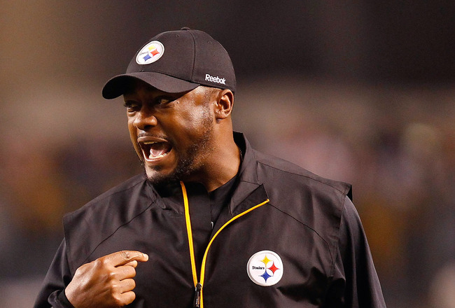 PITTSBURGH - NOVEMBER 14:  Head coach Mike Tomlin of the Pittsburgh Steelers talks to the referees during the game against the New England Patriots on November 14, 2010 at Heinz Field in Pittsburgh, Pennsylvania.  (Photo by Jared Wickerham/Getty Images)
