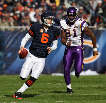 CHICAGO - NOVEMBER 14: Jay Cutler #6 of the Chicago Bears runs for a first down as Ray Edwards #91 of the Minnesota Vikings gives chase at Soldier Field on November 14, 2010 in Chicago, Illinois. The Bears defeated the Vikings 27-13. (Photo by Jonathan Da