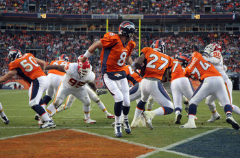 DENVER - NOVEMBER 14:  Quarterback Kyle Orton #8 of the Denver Broncos hands off to running back Knowshon Moreno #27 from his own endzone against the Kansas City Chiefs at INVESCO Field at Mile High on November 14, 2010 in Denver, Colorado. The Broncos de