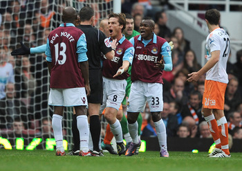 LONDON, ENGLAND - NOVEMBER 13:  Scott Parker and Victor Obinna of West Ham appeal to referee Kevin Friend for a hand ball during the Barclays Premier League match between West Ham United and Blackpool at Boleyn Ground on November 13, 2010 in London, Engla