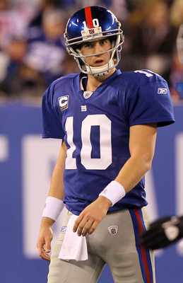 EAST RUTHERFORD, NJ - NOVEMBER 14:  Eli Manning #10 of the New York Giants walks off the field after losing the ball on a fumble in the fourth quarter against of the Dallas Cowboys on November 14, 2010 at the New Meadowlands Stadium in East Rutherford, Ne