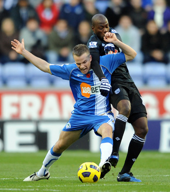 WIGAN, ENGLAND - NOVEMBER 13:  Tom Cleverley of Wigan Athletic competes with Youssuf Mulumbu of West Bromwich Albion during the Barclays Premier League match between Wigan Athletic and West Bromwich Albion at DW Stadium on November 13, 2010 in Wigan, Engl