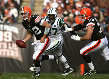 CLEVELAND - NOVEMBER 14:  Quarterback Colt McCoy #12 of the Cleveland Browns runs away from linebacker Calvin Pace #97 of the New York Jets at Cleveland Browns Stadium on November 14, 2010 in Cleveland, Ohio.  (Photo by Matt Sullivan/Getty Images)