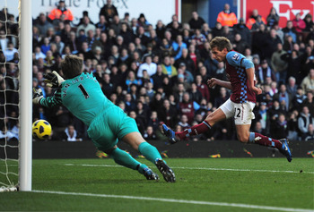 BIRMINGHAM, ENGLAND - NOVEMBER 13:  Marc Albrighton of Aston Villa scores his team's second goal past goalkeeper Edwin Van Der Sar of Manchester United during the Barclays Premier League match between Aston Villa and Manchester United at Villa Park on Nov