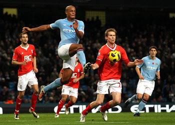 MANCHESTER, ENGLAND - NOVEMBER 13:  Vincent Kompany of Manchester City challenges Alexander Hleb of Birmingham City during the Barclays Premier League match between Manchester City and Birmingham City at City of Manchester Stadium on November 13, 2010 in