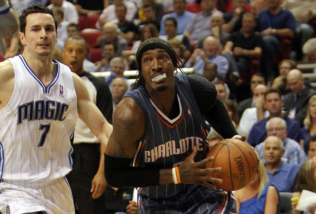 ORLANDO, FL - APRIL 21:  Gerald Wallace #3 of the Charlotte Bobcats drives past J.J. Redick #7 of the Orlando Magic in Game Two of the Eastern Conference Quarterfinals during the 2010 NBA Playoffs at Amway Arena on April 21, 2010 in Orlando, Florida. The