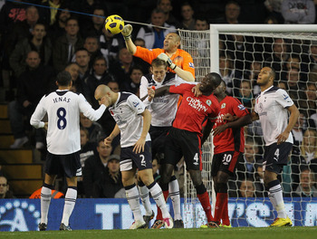 LONDON, ENGLAND - NOVEMBER 13:  Heurelho Gomes of Tottenham punches clear of goal during the Barclays Premier League match between Tottenham Hotspur and Blackburn Rovers at White Hart Lane on November 13, 2010 in London, England.  (Photo by Hamish Blair/G