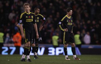 STOKE ON TRENT, ENGLAND - NOVEMBER 13: Fernando Torres,David Ngog and Lucas Leiva of Liverpool show their dejection after Stoke have scored the second goal during the Barclays Premier League match between Stoke City and Liverpool at Britannia Stadium on N