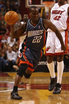 MIAMI - APRIL 8:  Brevin Knight #22 of the Charlotte Bobcats drives the ball past James Posey #42 of the Miami Heat during the game at  American Airlines Arena on April 8,  2007 in Miami, Florida. The Bobcats won 111-103.  NOTE TO USER: User expressly ack