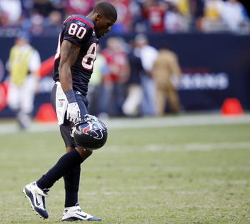 HOUSTON - NOVEMBER 07:  Wide receiver Andre Johnson #80 walks off the field after losing control of a pass that was intercepted by San Diego Charger Paul Oliver at Reliant Stadium on November 7, 2010 in Houston, Texas.  (Photo by Bob Levey/Getty Images)