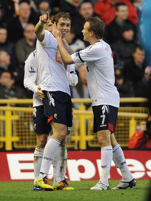 WOLVERHAMPTON, ENGLAND - NOVEMBER 13: Johan Elmander of Bolton celebrates with team-mate Matthew Taylor (R) after scoring the 2-0 goal during the Barclays Premier League match between Wolverhampton Wanderers and Bolton Wanderers at Molineux on November 13
