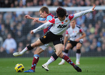 BIRMINGHAM, ENGLAND - NOVEMBER 13:  Ji-Sung Park of Manchester United is tackled by Marc Albrighton of Aston Villa during the Barclays Premier League match between Aston Villa and Manchester United at Villa Park on November 13, 2010 in Birmingham, England