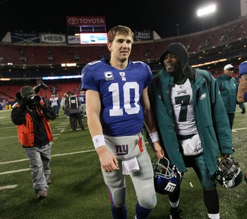 EAST RUTHERFORD, NJ - DECEMBER 13:  Eli Manning #10 of the New York Giants walks off the field with Michael Vick #7 of the Philadelphia Eagles at Giants Stadium on December 13, 2009 in East Rutherford, New Jersey.  (Photo by Nick Laham/Getty Images)