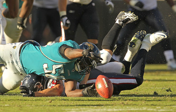 JACKSONVILLE, FL - NOVEMBER 14: Jacob Cutrera #58 of the Jacksonville Jaguars recovers a fumble from Joel Dreessen #85 during a game against the Houston Texans at EverBank Field on November 14, 2010 in Jacksonville, Florida.  (Photo by Mike Ehrmann/Getty