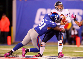 EAST RUTHERFORD, NJ - OCTOBER 03:  Justin Tuck #91 of the New York Giants sacks Caleb Hanie #12 of the Chicago Bear at New Meadowlands Stadium on October 3, 2010 in East Rutherford, New Jersey.  (Photo by Andrew Burton/Getty Images)