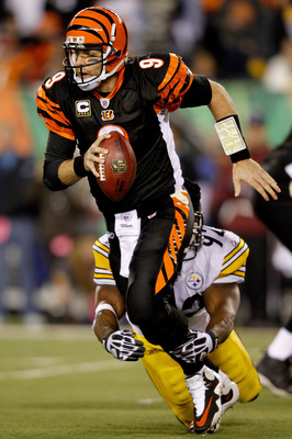 CINCINNATI - NOVEMBER 08:  Carson Palmer #9 of the Cincinnati Bengals is brought down from behind by James Harrison #92 of the Pittsburgh Steelers at Paul Brown Stadium on November 8, 2010 in Cincinnati, Ohio.  (Photo by Matthew Stockman/Getty Images)