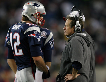 FOXBORO, MA - NOVEMBER 22:  Tom Brady #12 of the New England Patriots talks with head coach Bill Belichick in fourth quarter against the New York Jets on November 22, 2009 at Gillette Stadium in Foxboro, Massachusetts. The Patriots defeated the Jets 31-14