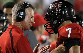 LUBBOCK, TX - SEPTEMBER 18:  Head coach Tommy Tuberville of the Texas Tech Red Raiders talks with Will Ford #7 during play against the Texas Longhorns at Jones AT&T Stadium on September 18, 2010 in Lubbock, Texas.  (Photo by Ronald Martinez/Getty Images)