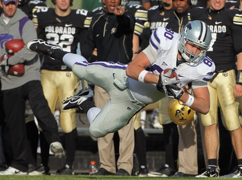 BOULDER, CO - NOVEMBER 20:  Tight end Travis Tannahill #80 of the Kansas State Wildcats dives to catch a 24 yard pass from quarterback Carson Coffman for a first down as the Colorado Buffaloes bench reacts at Folsom Field on November 20, 2010 in Boulder,