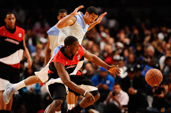 NEW YORK - APRIL 17:  Dion Waiters #2 of East team and Cory Joseph #15 of West Team reach for the ball during the National Game at the 2010 Jordan Brand classic at Madison Square Garden on April 17, 2010 in New York City.  (Photo by Jeff Zelevansky/Getty
