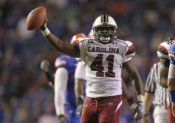 GAINESVILLE, FL - NOVEMBER 13:  Josh Dickerson #41 of the South Carolina Gamecocks holds up the ball after recovering a fumble during a game against the Florida Gators at Ben Hill Griffin Stadium on November 13, 2010 in Gainesville, Florida.  (Photo by Mi