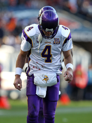 CHICAGO - NOVEMBER 14: Brett Favre #4 of the Minnesota Vikings walks back to the field of play from the sidelines during a game against the Chicago Bears at Soldier Field on November 14, 2010 in Chicago, Illinois. The Bears defeated the Vikings 27-13. (Ph