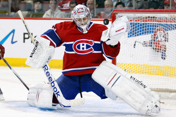 MONTREAL, QC - OCTOBER 25:  Carey Price #31 of the Montreal Canadiens makes a glove save on the puck during the NHL game against the Phoenix Coyotes at the Bell Centre on October 25, 2010 in Montreal, Quebec, Canada.  The Canadiens defeated the Coyotes 3-