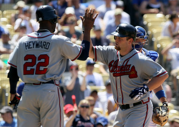 LOS ANGELES, CA - JUNE 06:  Brian McCann #16 of the Atlanta Braves receives a high five from Jason Heyward #22 after hitting a two-run homerun in the fifth inning against the Los Angeles Dodgers at Dodger Stadium on June 6, 2010 in Los Angeles, California