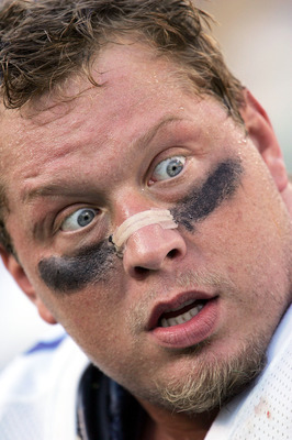 GREEN BAY, WI - OCTOBER 24: Chad Eaton #99 of the Dallas Cowboys talks with teammates on the bench during a game against the Green Bay Packers at Lambeau Field on October 24, 2004 in Green Bay, Wisconsin. The Packers defeated the Cowboys 41-20. (Photo by
