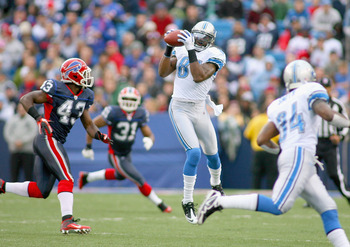 ORCHARD PARK, NY - NOVEMBER 14: Calvin Johnson #81 of the Detroit Lions makes a catch behind Bryan Scott #43 of the Buffalo Bills  at Ralph Wilson Stadium on November 14, 2010 in Orchard Park, New York. Buffalo won 14-12. (Photo by Rick Stewart/Getty Imag