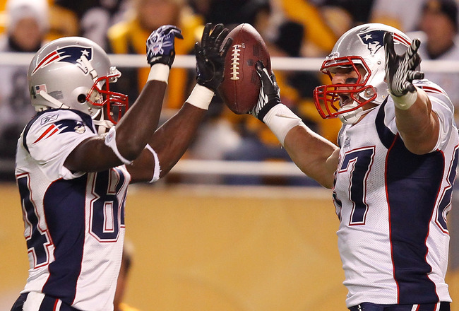 PITTSBURGH - NOVEMBER 14: Deion Branch #84 and Rob Gronkowski #87 of the New England Patriots celebrate after scoring a touchdown during the game against the Pittsburgh Steelers on November 14, 2010 at Heinz Field in Pittsburgh, Pennsylvania.  (Photo by J